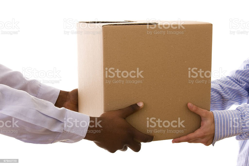 Pair of hands giving cardboard box to another pair of hands royalty-free stock photo