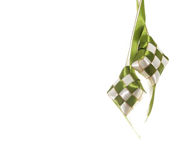 pair of hanging ribbon ketupats - ketupat stock pictures, royalty-free photos & images