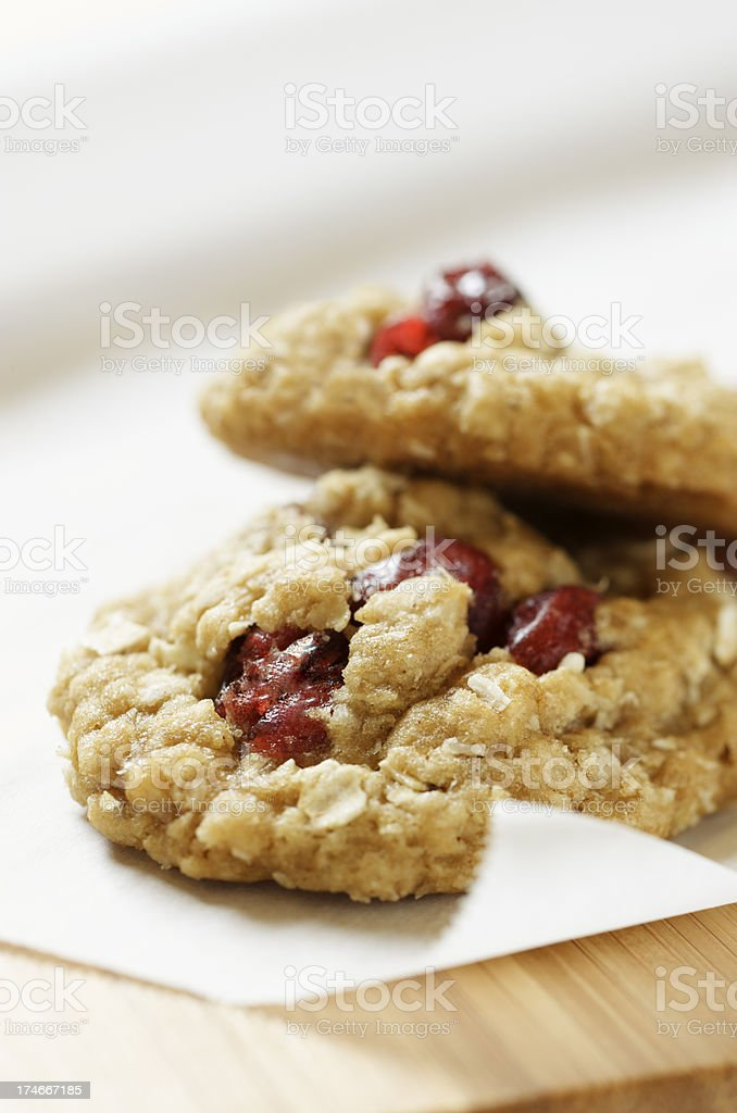 Pair of Healthy Cranberry Oatmeal Cookies on White Paper stock photo