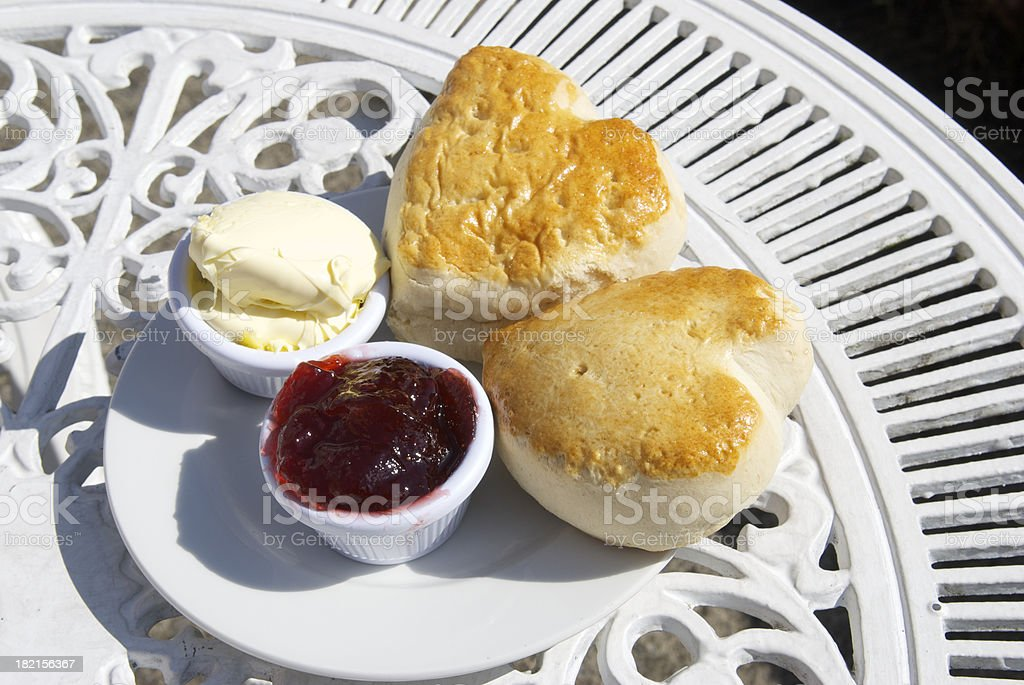 Pair of Heart Shaped Scones with Cream and Jam stock photo