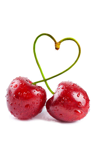 Pair of heart-shaped sweet cherries stock photo