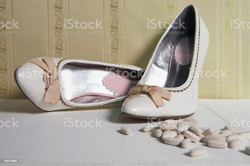 Pair of high heeled shoes and tablets royalty-free 스톡 사진