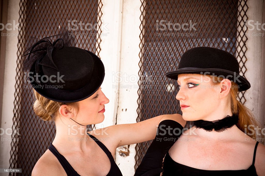 Pair of jazz ballet dancers wearing costume pose for camera. royalty-free stock photo