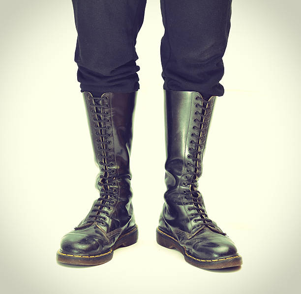 pair of knee-high 20 eyelet black lace-up boots - vintage - postal worker stok fotoğraflar ve resimler
