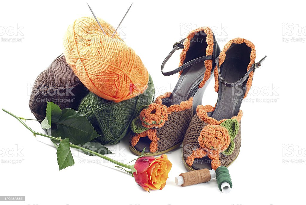 Pair of knitted shoes royalty-free stock photo