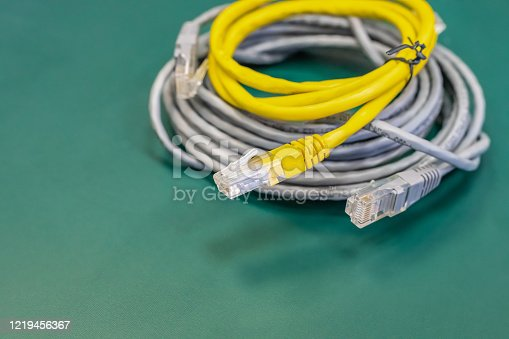 istock pair of lan wires with rj45 connector gray and yellow, engineering background 1219456367