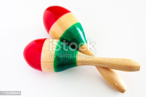 istock Pair of maracas painted in the colors of the Mexican flag on white background. Cinco de mayo background concept 1132590044