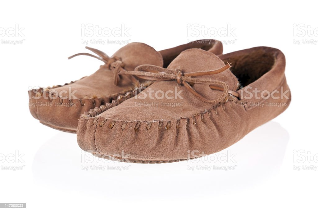Pair of moccasin slippers isolated stock photo