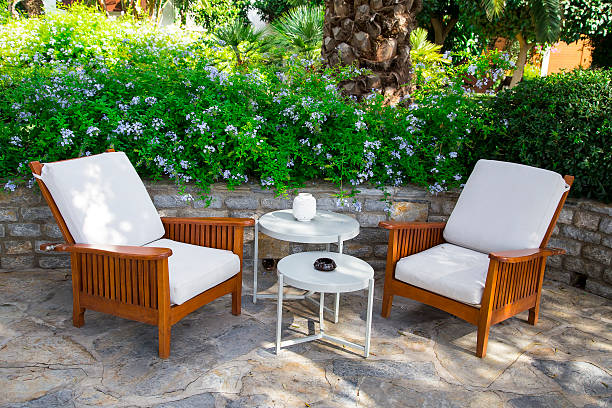 Pair of modern comfortable garden sofa in the home garden stock photo