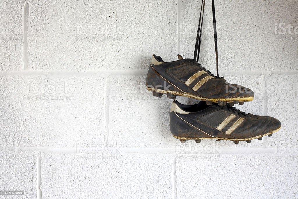 Pair of muddy black football boots stock photo