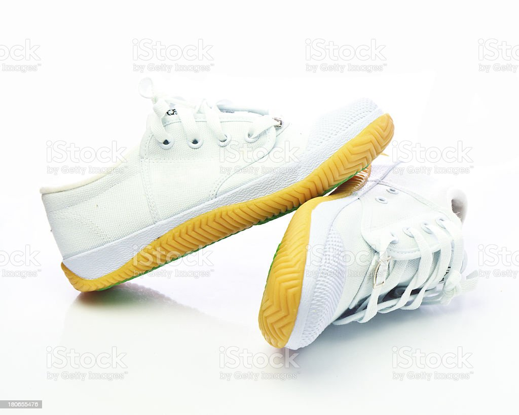 Pair of new white sneakers royalty-free stock photo