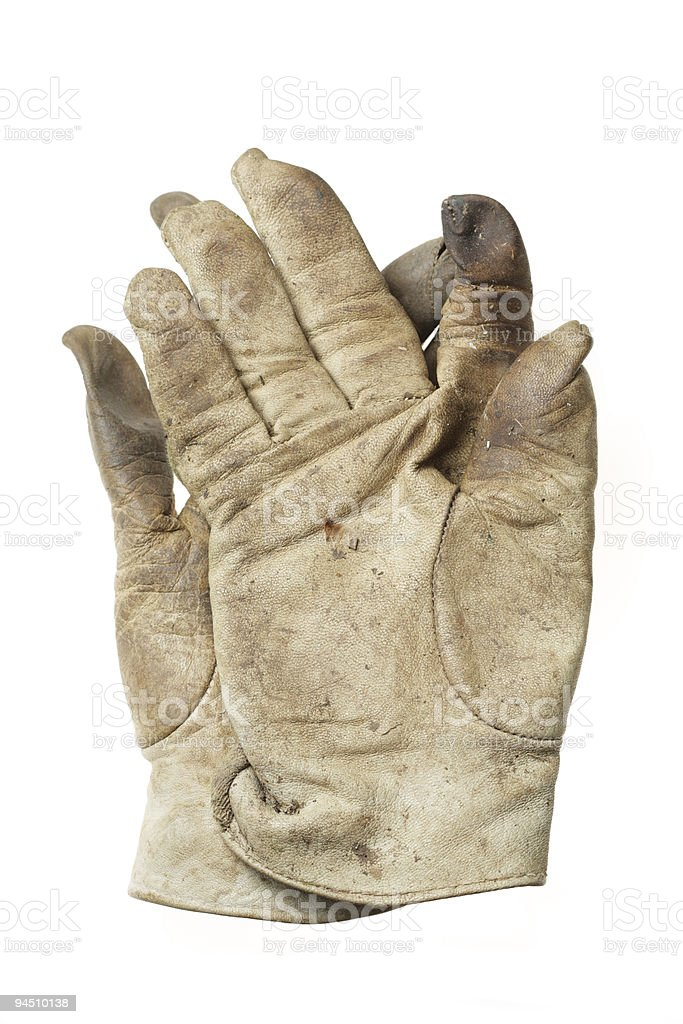 pair of old and used gardening gloves royalty-free stock photo