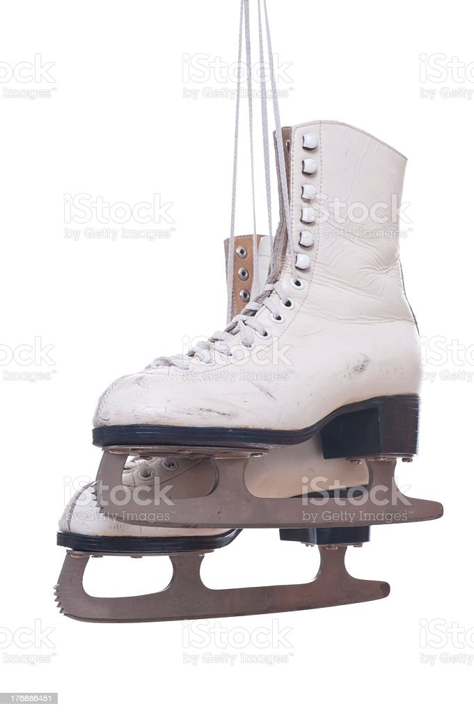 Pair of old rusted ice skates on a white background stock photo