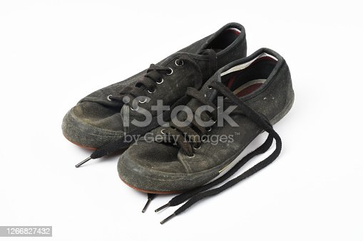 A pair of old shoes on white background