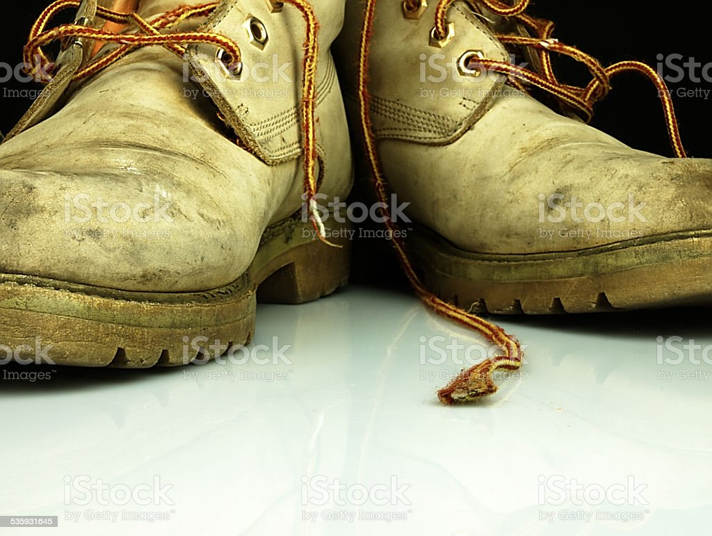 Pair of old, worn heavy boots. stock photo