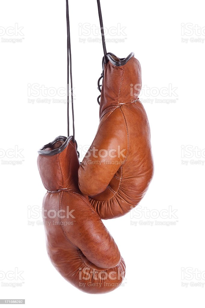 Pair of old-fashioned boxing gloves on a white background stock photo