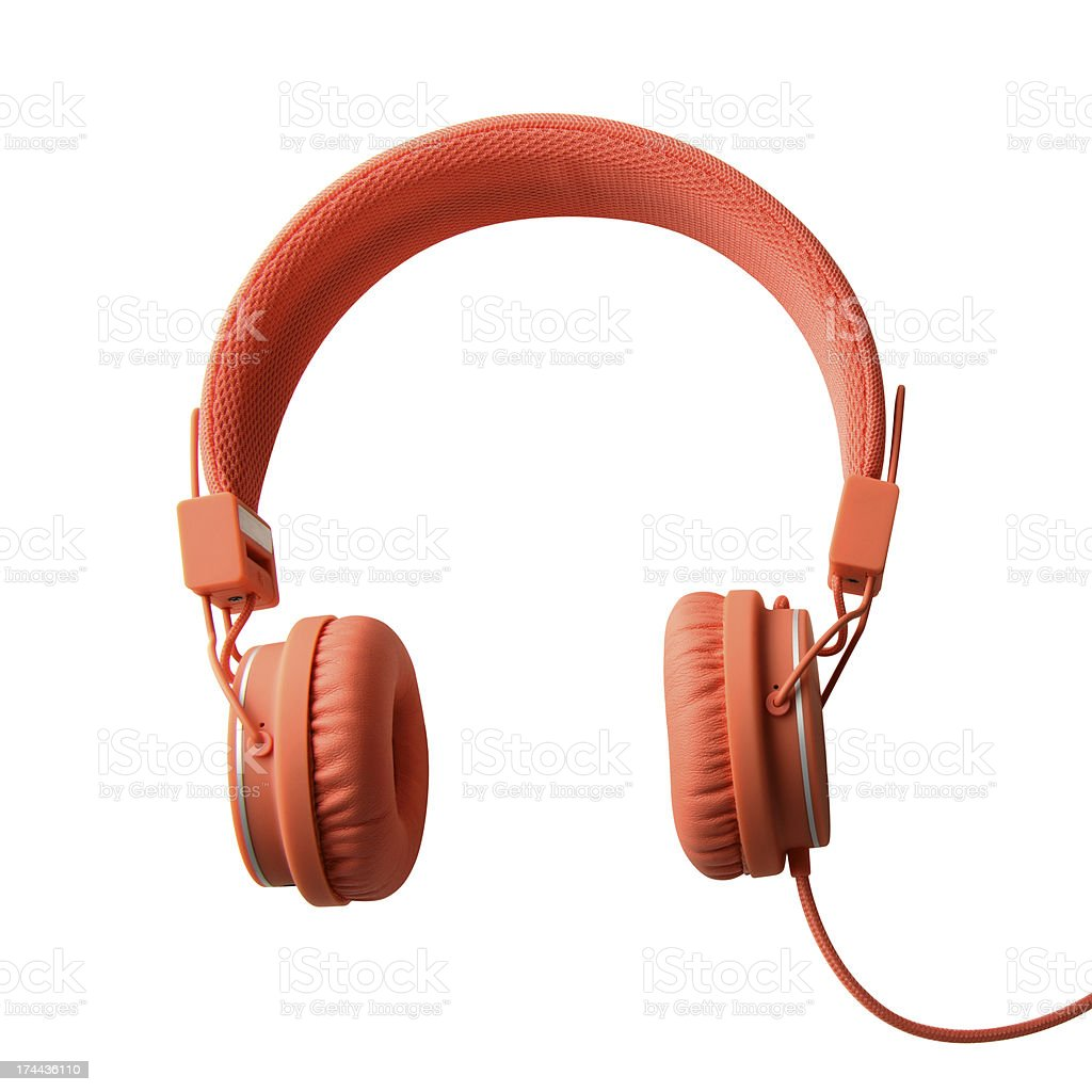 A pair of orange headphones with a wire royalty-free stock photo