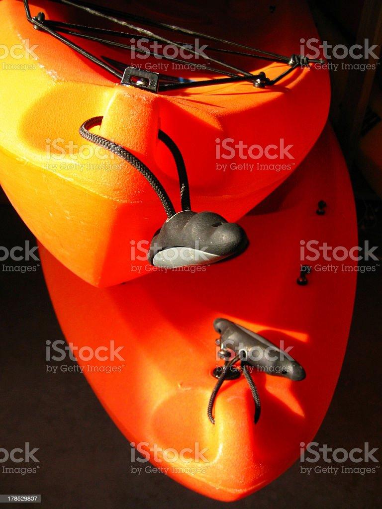 Pair of orange kayaks royalty-free stock photo