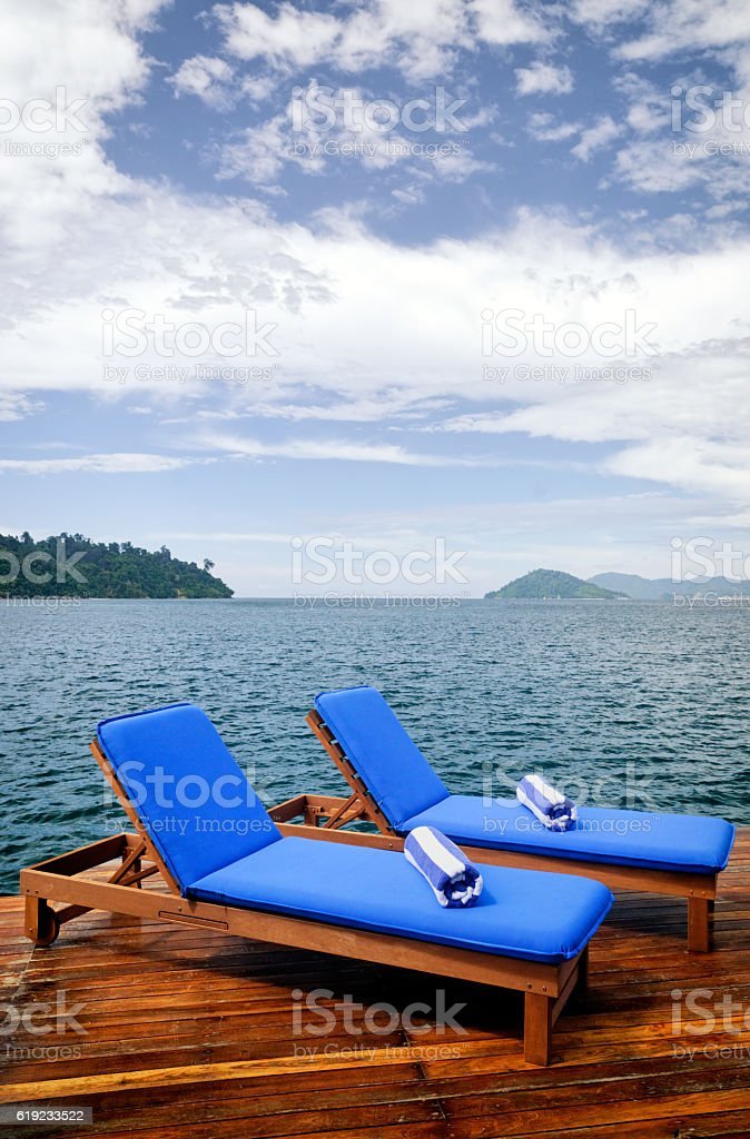 Pair of outdoor reclining seats on deck stock photo