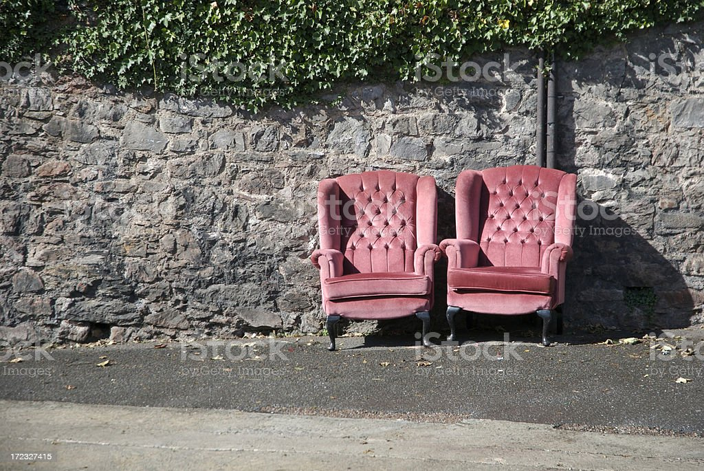Pair of Pink Love Seats Sitting Together in the Sun royalty-free stock photo