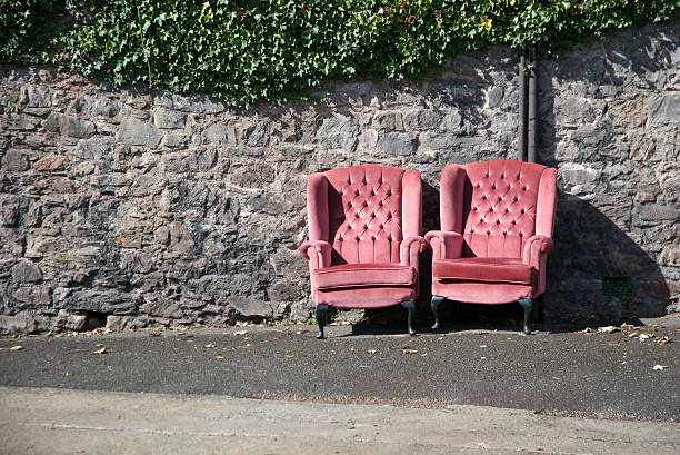 Pair of Pink Love Seats Sitting Together in the Sun stock photo