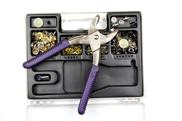 Pair of pliers and a toolbox stock photo