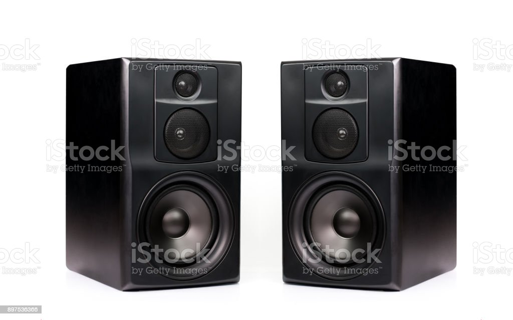 Pair of professional modern audio speakers in black wooden casing isolated on white background stock photo