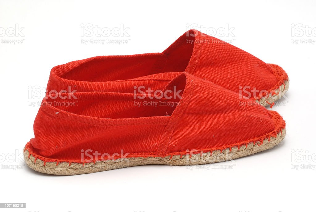 Pair of red espadrilles stock photo