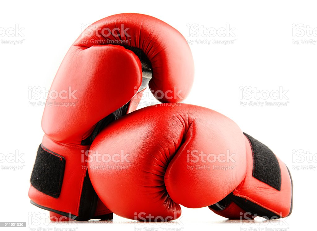 Pair of red leather boxing gloves isolated on white stock photo