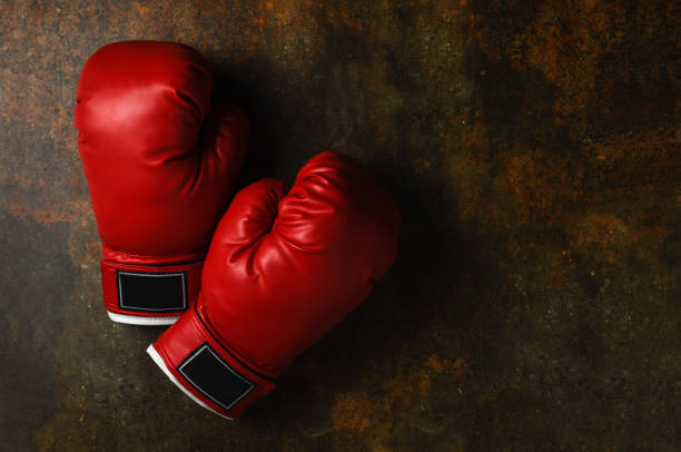 Pair of red leather boxing gloves stock photo