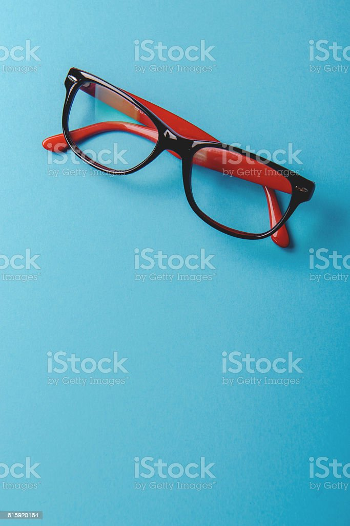 pair of red plastic-rimmed eyeglasses stock photo
