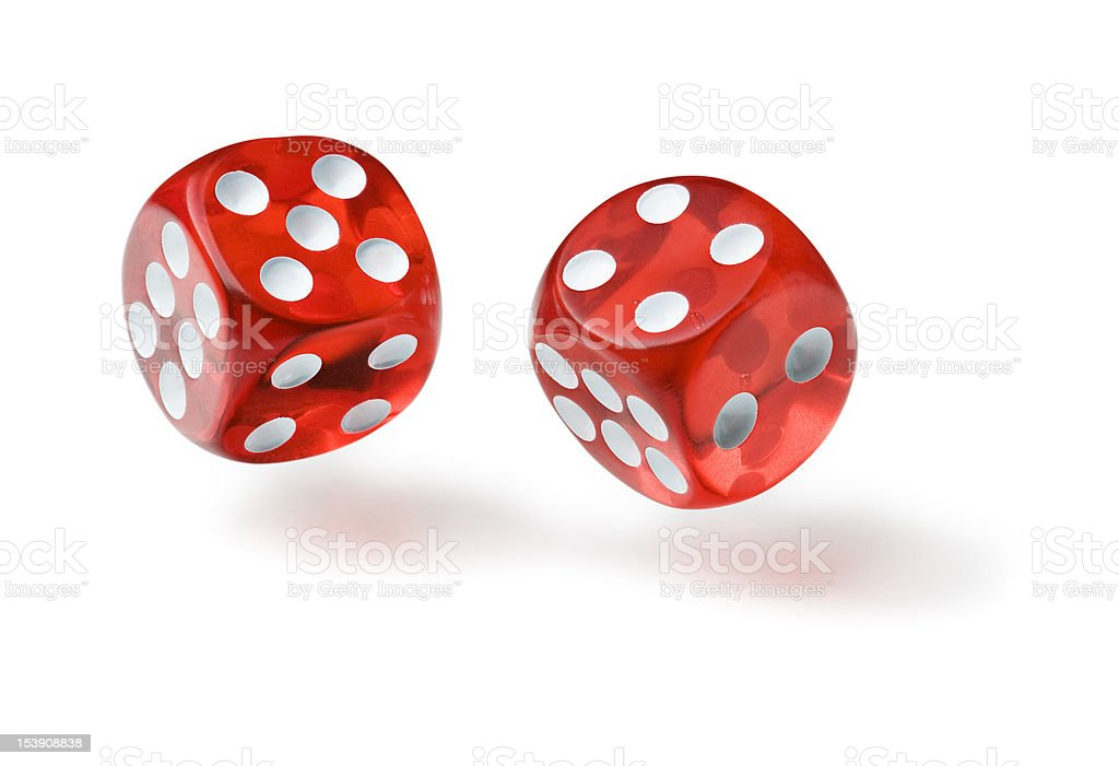Pair of red translucent die in mid air stock photo