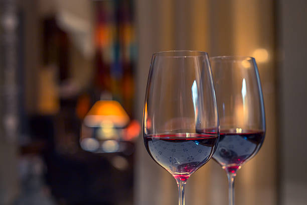 pair of red wine glasses, closeup shot - pair stock photos and pictures