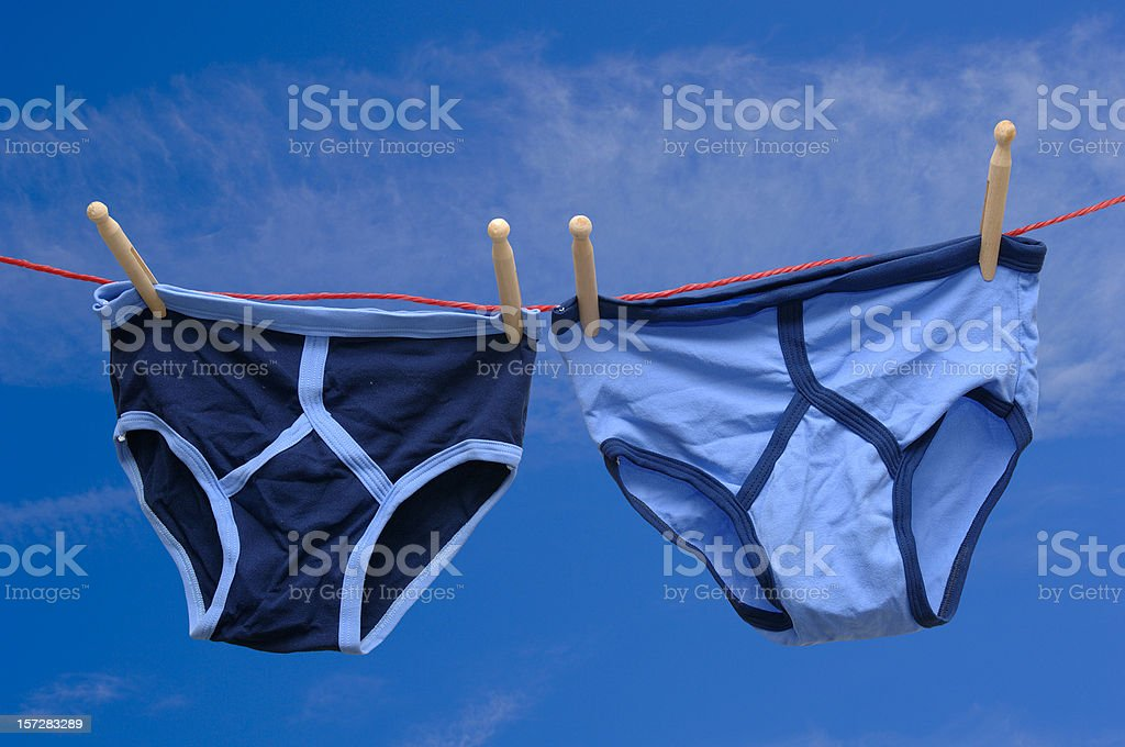 pair of retro male underpants on a washing line stock photo
