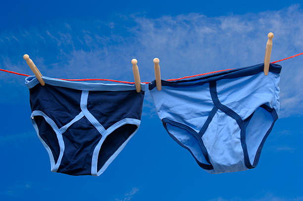 pair of retro male underpants on a washing line - washing line stock photos and pictures