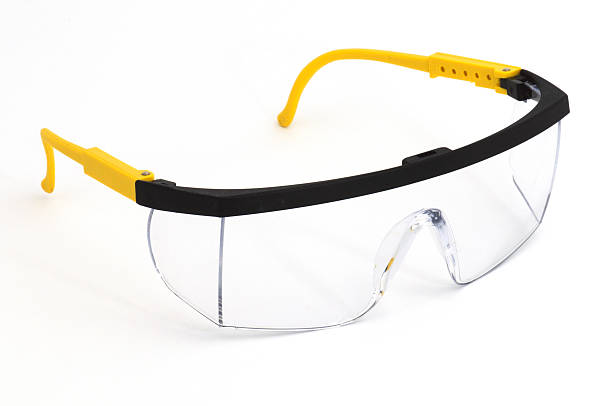 Pair of safety goggles on a background Safety Glasses protective eyewear stock pictures, royalty-free photos & images