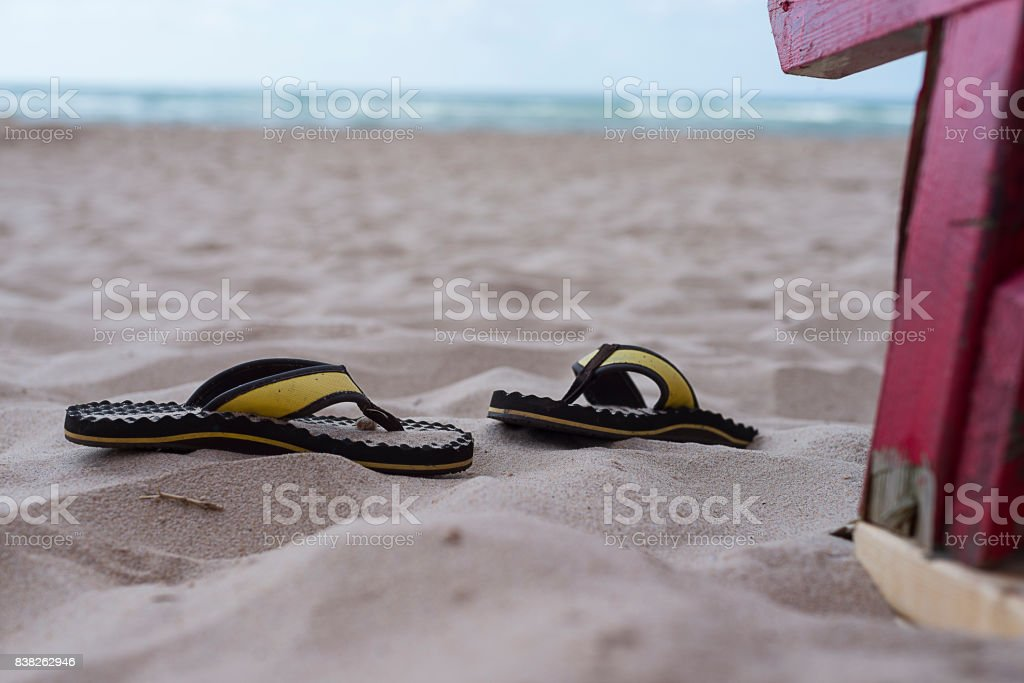 Pair of Sandals on the beach stock photo