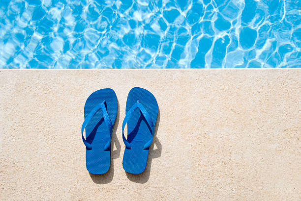 Pair of sandals  poolside stock pictures, royalty-free photos & images