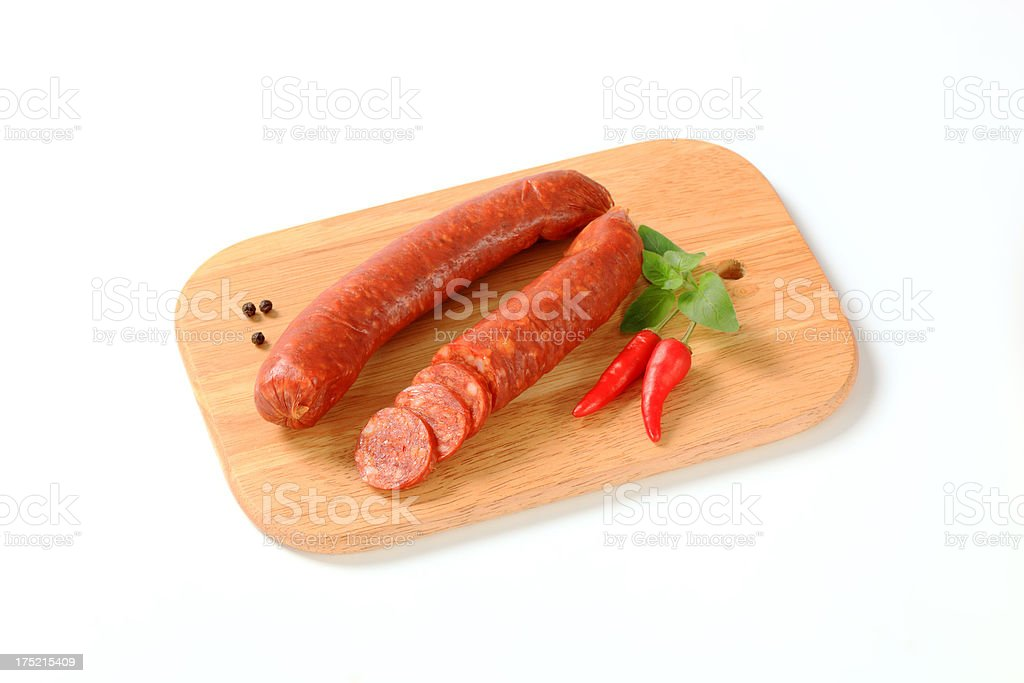 Pair of sausages on a cutting board royalty-free stock photo