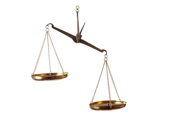 A Pair Of Scales On White Background For Justice And Equality stock photo