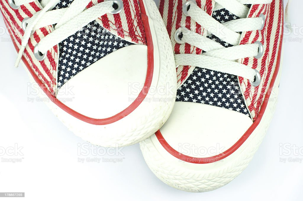 Pair of shoes with american stars and stripes decoration royalty-free stock photo