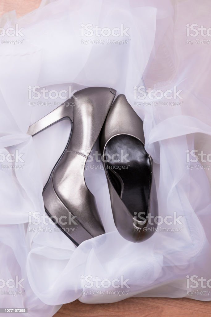 Silver high heels in the shoe box