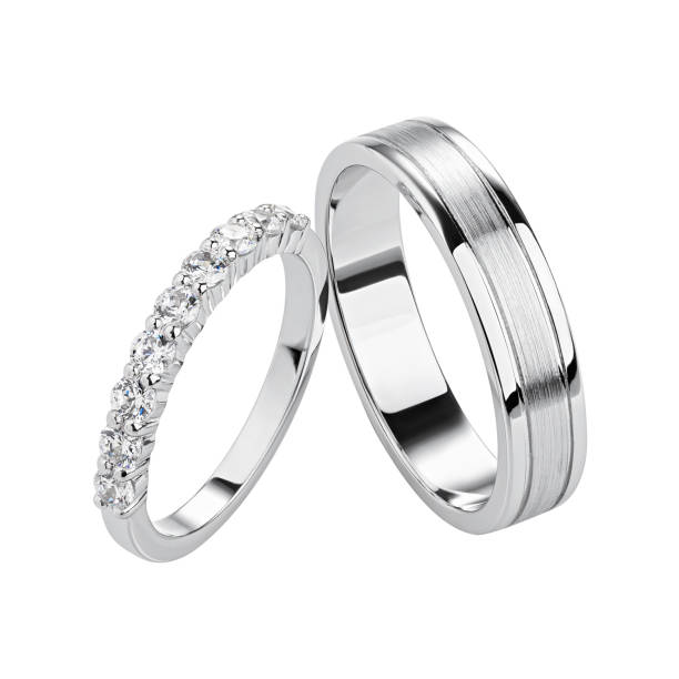 Pair of silver wedding rings isolated on white background.