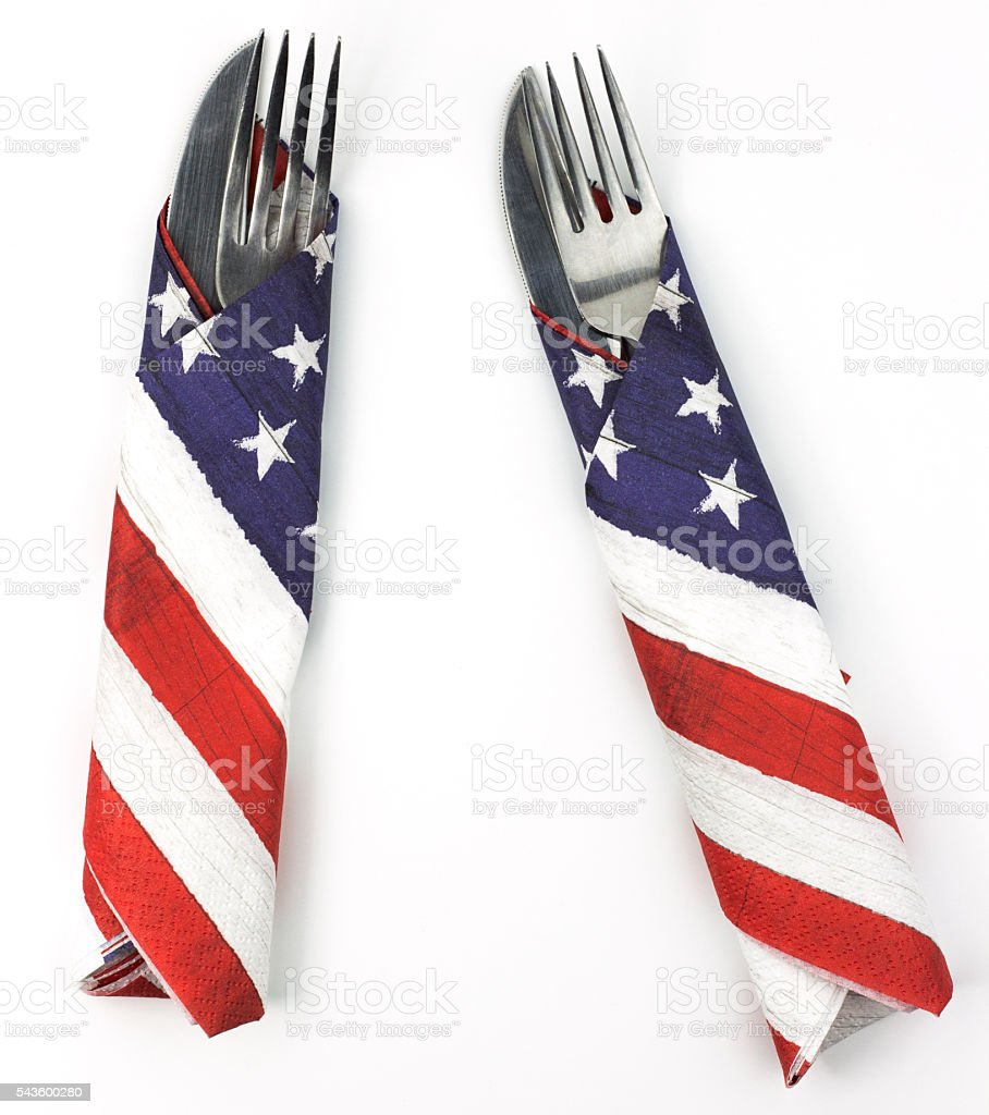 Pair of silverware wrapped in American flag napkins stock photo