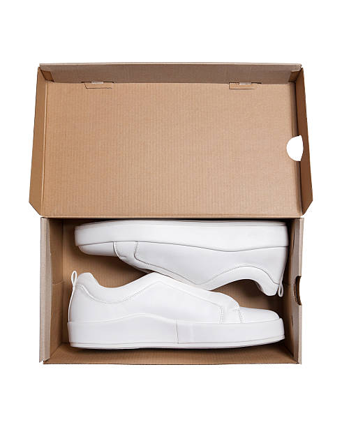 pair of sneakers in shoe cardboard box with clipping path - neue sneaker stock-fotos und bilder