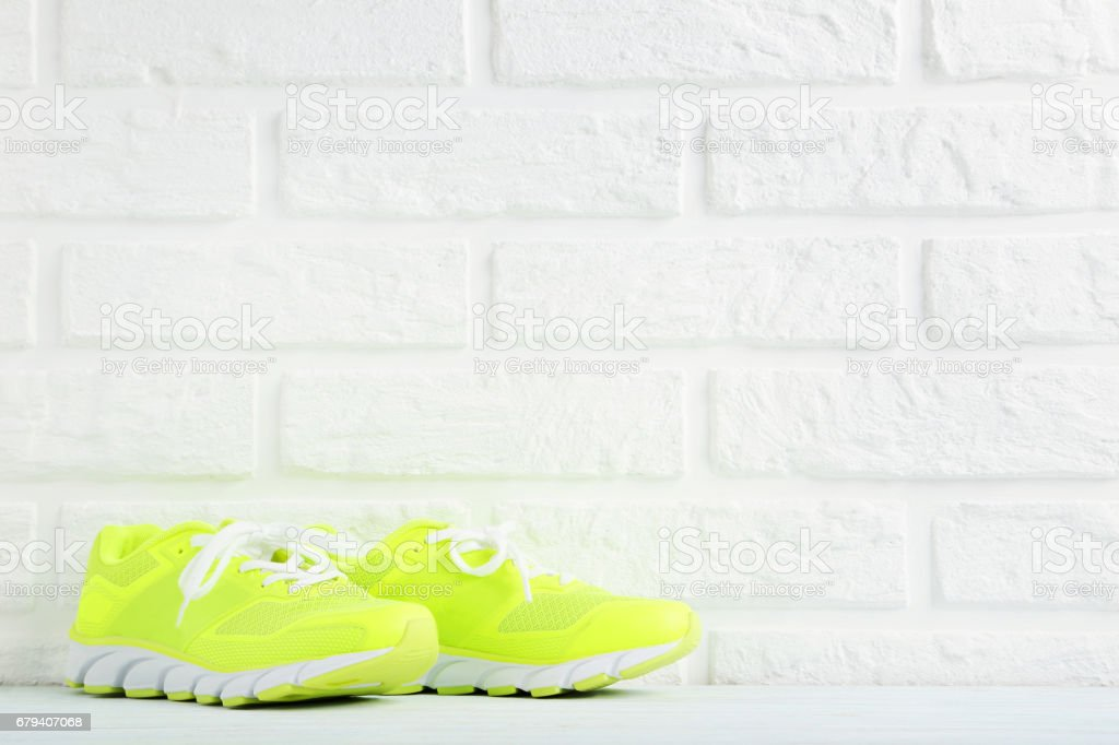Pair of sport shoes on a brick wall background royalty-free stock photo