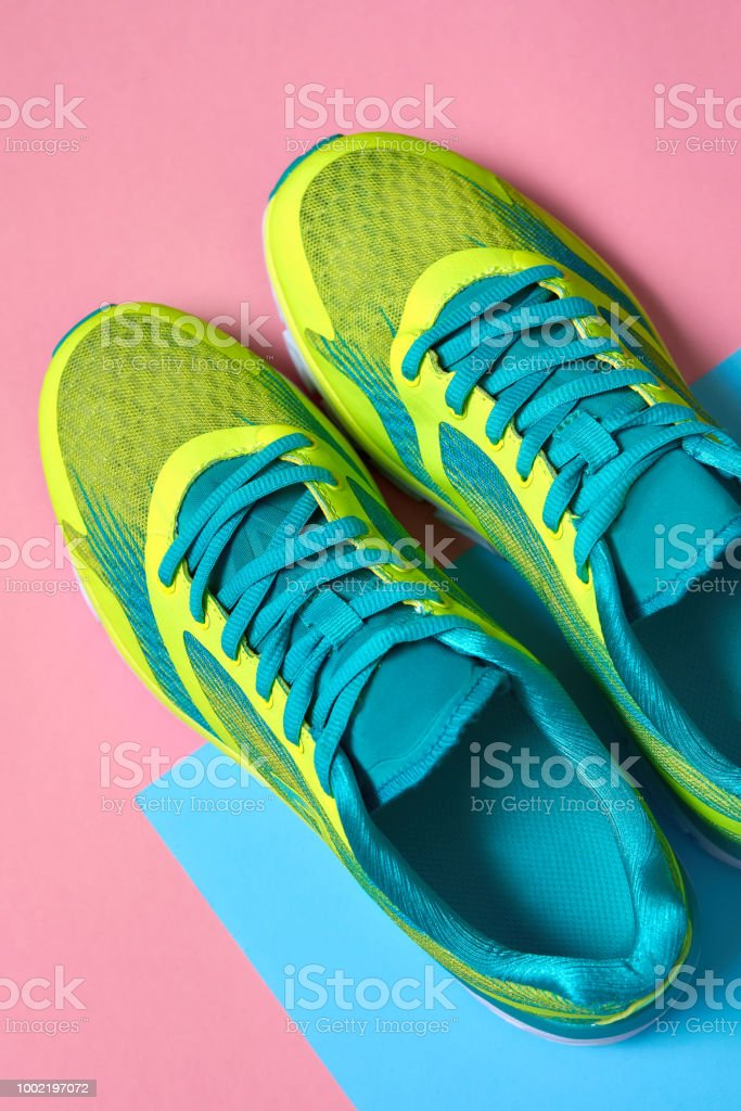1472201fe7d2f Pair of sport shoes on colorful background. New sneakers on pink and blue  pastel background