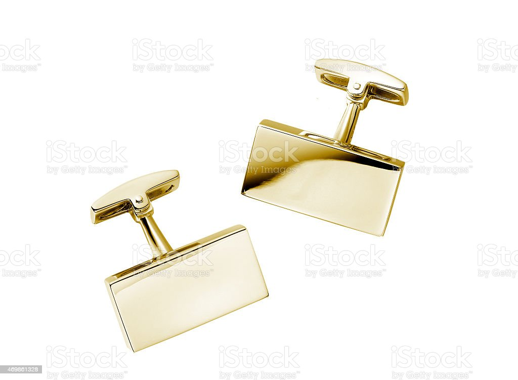 pair of stainless steel cufflinks on white stock photo