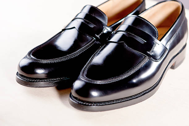 Pair of Stylish Expensive Modern Leather Black Penny Loafers Shoes