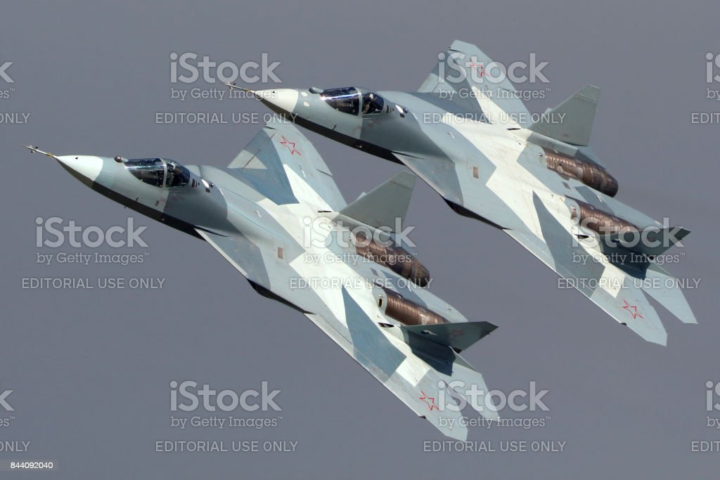 Pair of Sukhoi T-50 PAK-FA 052 BLUE and 051 BLUE modern russian jet fighters performing demonstration flight in Zhukovsky during MAKS-2013 airshow. stock photo